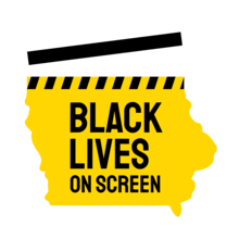 black and gold clapboard shaped like state of iowa